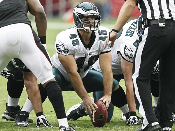 Philadelphia Eagles´ Jon Dorenbos (46) waits to snap the ball as Arizona Cardinals´ Daryl Washington (58) and umpire Randy Tabler waits for the snap as well during the second half of an NFL football game Sunday, Sept. 23, 2012, in Glendale, Ariz.(AP Photo/Paul Connors)