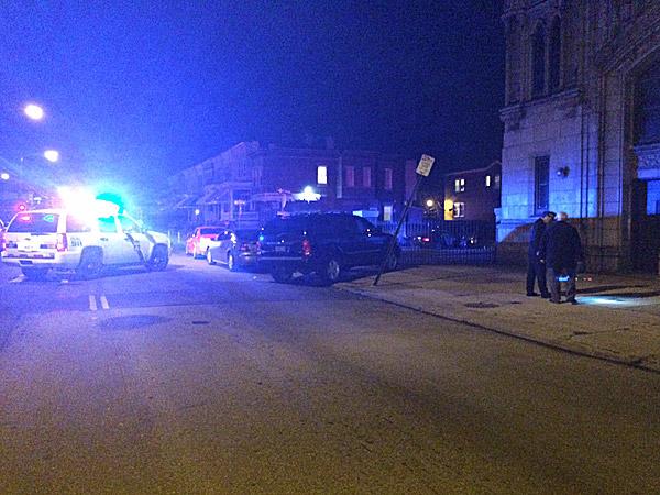 Police investigate the scene of a fatal shooting on Limekiln Pike near Ridley Street. (Vinny Vella/Staff)
