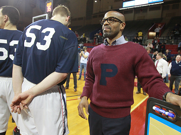 Jerome Allen brought back his old varsity sweater one more time for the final game of his coaching tenure at Penn. His players wore t-shirts with Allen´s old number during pregame warmups. (Charles Fox/Staff Photographer)