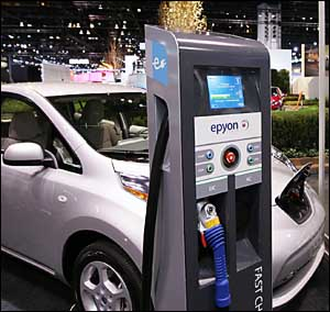 A Nissan Leaf is seen with the fast, 30-min charger at  the Chicago auto show.