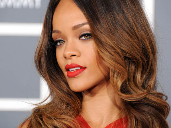 Rihanna wearing a red shade of lipstick at the Grammys. What would RiRi say now? (AP Photo)