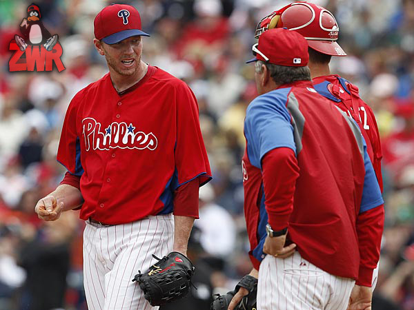 Phillies starting pitcher Roy Halladay talks with pitching coach Rich Dubee. (David Maialetti/Staff Photographer)