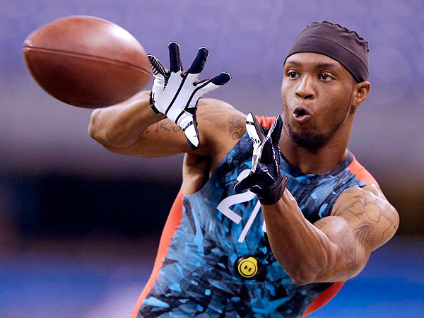 West Virginia receiver Tavon Austin makes a catch as he runs a drill at the NFL football scouting combine in Indianapolis, Sunday, Feb. 24, 2013. (Michael Conroy/AP)