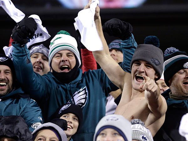 Eagles fans cheer during the first half of an NFL wild-card playoff football game against the New Orleans Saints, Saturday, Jan. 4, 2014, in Philadelphia. (Julio Cortez/AP file)