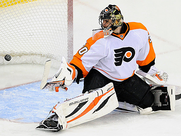Flyers goaltender Ilya Bryzgalov watches the puck go into the net for a goal by the Devils´ Andrei Loktionov during the second period. (Bill Kostroun/AP)