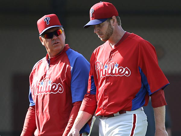 Phillies pitching coach Rich Dubee and starting pitcher Roy Halladay. (Matt Slocum/AP)