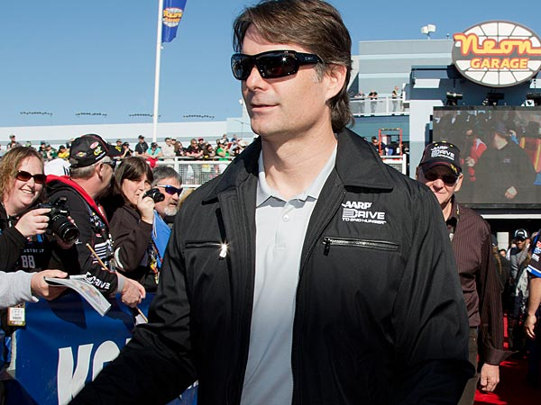 Jeff Gordon greets fan as he walks to the drivers meeting before the NASCAR Sprint Cup Series auto race on Sunday, March 10, 2013, in Las Vegas. (AP Photo/Julie Jacobson)