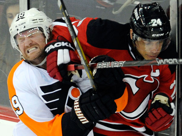 Scott Hartnell (left) runs into the elbow of New Jersey Devils´ Bryce Salvadore during the second period of an NHL hockey game on Wednesday, March 13, 2013, in Newark, N.J. (Bill Kostroun/AP)