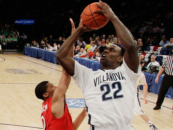 Villanova´s JayVaughn Pinkston (22) drives past St. John´s Jamal Branch (0) during the first half of an NCAA college basketball game at the Big East Conference tournament, Wednesday, March 13, 2013, in New York. (Frank Franklin II/AP)