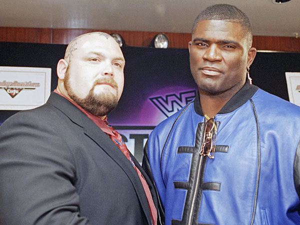 Former New York Giants Lawrence Taylor, right, poses with professional wrestler Bam Bam Bigelow during a New York news conference Tuesday, Feb. 28, 1995. Taylor, signed with the World Wrestling Federation to battle the 390-pound Bigelow in a feature match at WrestleMania XI. (Marty Lederandler/AP file)