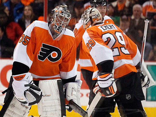Flyers goalies Steve Mason, left, and Ray Emery, right. (Tom Mihalek/AP)