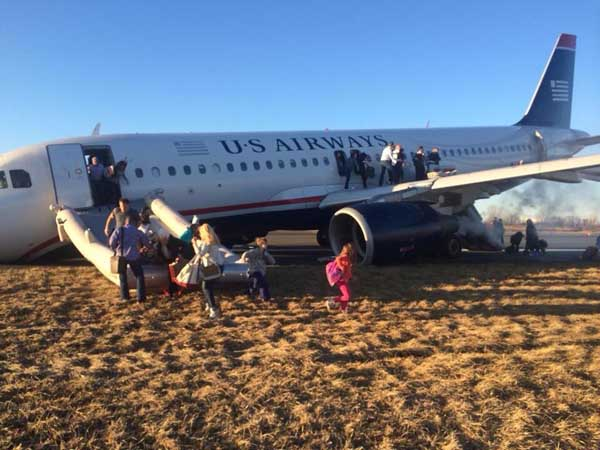 A plane skidded off the runway at PHL after a botched takeoff. This photo of the event was posted on Facebook.