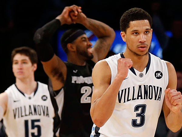 Villanova´s Ryan Arcidiacono (15), who hit the deciding foul shots, with teammate Josh Hart after the victory in New York. (Yong Kim/Staff Photographer)