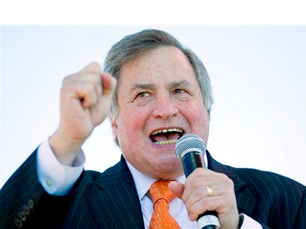 FILE - In this Sept. 12, 2010 file photo, political commentator Dick Morris speaks to the crowd during the &quot;Gateway to November&quot; rally hosted by the St. Louis Tea Party and Tea Party Patriots at the Gateway Arch in St. Louis. Morris acknowledged on Fox News Channel that some of the Republican presidential candidates that he talks about on the air have paid for advertisements in the newsletter he sends out to subscribers. Morris&acute; statement on Fox Monday, Dec. 5, 2011, was the latest in a handful of episodes that laid bare close ties between the media and political world during the campaign season. (AP Photo/Whitney Curtis, file)<br />
