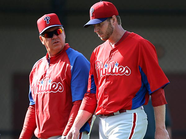 Philadelphia Phillies´ Roy Halladay, right, and Rich Dubee talk during a workout at baseball spring training, Thursday, Feb. 21, 2013, in Clearwater, in Fla. (AP Photo/Matt Slocum)