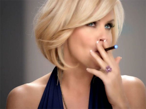 In this undated image from video provided by Resound Marketing in August 2013, Jenny McCarthy uses a blu eCig in a television advertisement. (AP Photo / Resound Marketing)