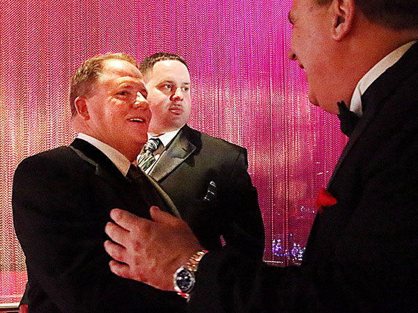 Chip Kelly shakes hands with well wishers, Friday March 14 2014, at the Maxwell Football Awards at the Revel Casino and Hotel in Atlantic City, N.J. (AP Photo/The Press of Atlantic City, Ben Fogletto)