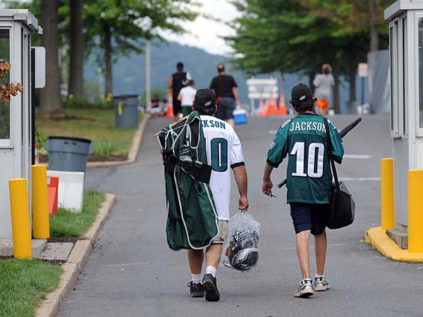 Eagles fans leave the complex after practice with memorabilia in hand during training camp at Lehigh University. (Tom Kelly IV / Staff Photographer)