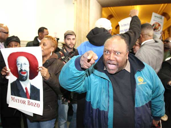 Protesters celebrate in the 4th floor hallway of City Hall last March after their disruptions forced Mayor Nutter to cancel his budget address to City Council. (Charles Fox / Staff Photographer)