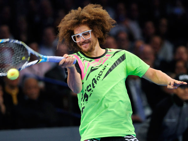 Redfoo fine-tuning his tennis prowess. (Bill Kostroun/AP)