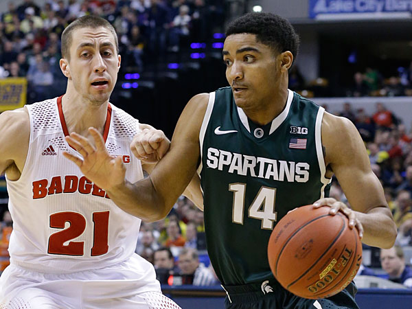 Michigan State guard Gary Harris (14) drives against Wisconsin guard Josh Gasser (21) in the first half of an NCAA college basketball game in the semifinals of the Big Ten Conference tournament Saturday, March 15, 2014, in Indianapolis. (Michael Conroy/AP)