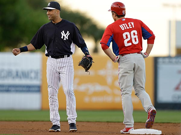 New York Yankees shortstop Derek Jeter (2) and Philadelphia Phillies second baseman Chase Utley (26) chat in a spring training baseball game in Tampa, Fla., Wednesday, March 13, 2013. (AP Photo/Kathy Willens)