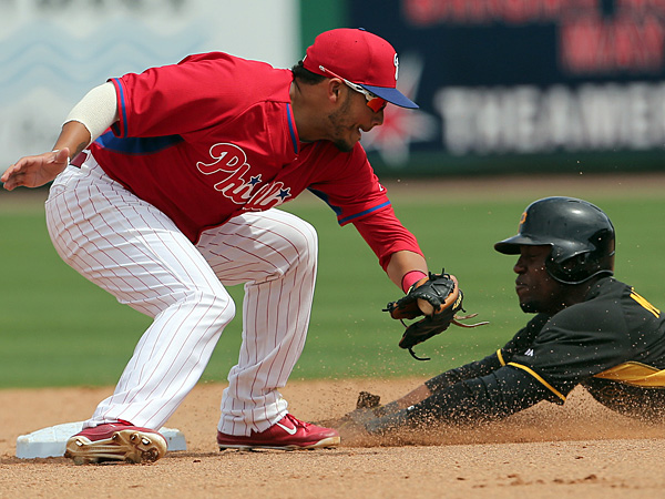 Starling Marte of the Pirates steals second base against Freddy Galvis on Sunday, March 16. (Yong Kim/Staff Photographer)