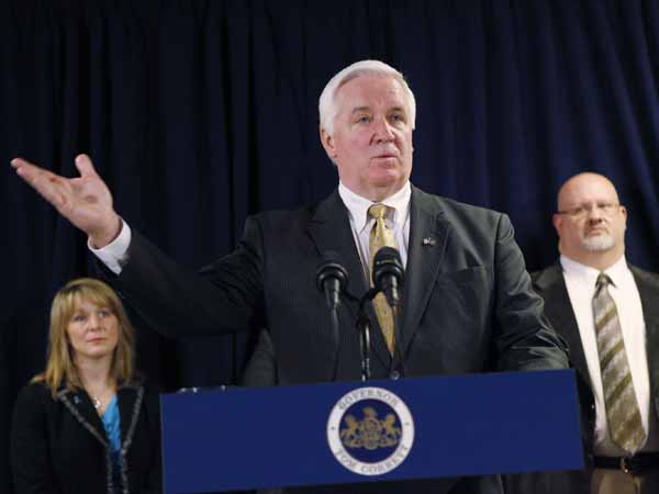 Governor Corbett talks about his budget proposal to increase funding for rape crisis services and prevention education at a press conference held at the offices of Women Organized Against Rape as Kristen Houser (left) and Ralph J. Riviello (right) listen. February 28, 2013. ( MICHAEL S. WIRTZ / Staff Photographer ).