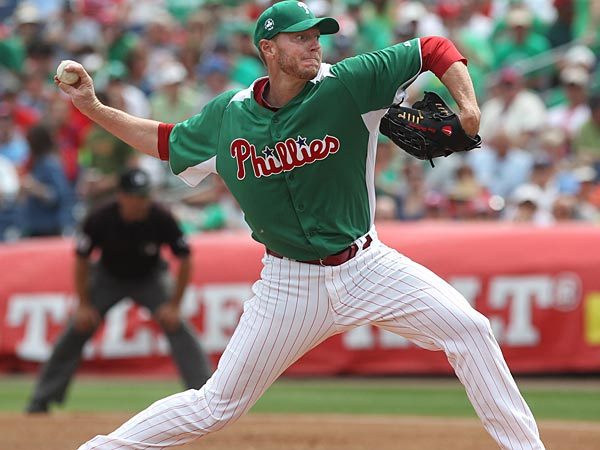 Phillies pitcher Roy Halladay rares back to throw a strike in the<br />first and only inning he worked on St Patrick&acute;s Day. He left the game<br />wth stomach flu. Philadephia Phillies defeated the Baltimore Orioles 5-3, in a Grapefruit League game at Bright House Field on March 17, 2013.  (Michael Bryant / Staff Photographer)