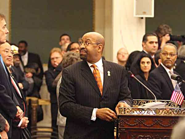 Mayor Michael Nutter looks up to the Council President as protesters, mainly from local labor unions, create too much noise in the balcony level of City Council Chambers for Mayor Nutter to deliver his budget address to City Council.  ( CHARLES FOX / Staff Photographer )