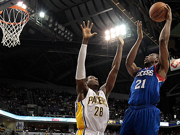 76ers forward Thaddeus Young shoots over Pacers center Ian Mahinmi. (AJ Mast/AP)