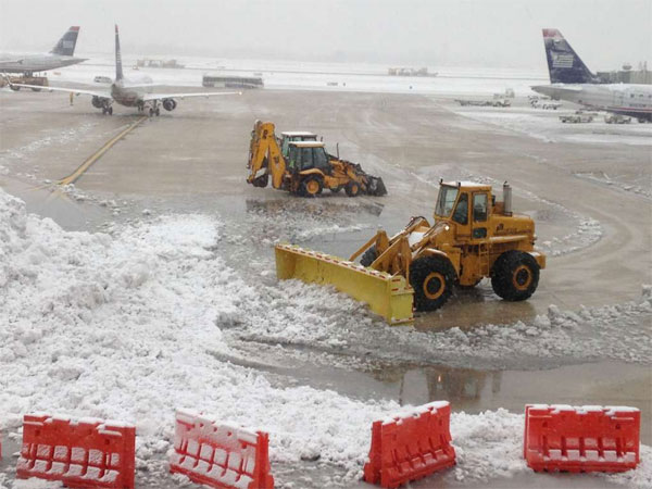 Crews clean up snow at Philadelphia International Airport during the Feb. 3 storm. (AP Photo)