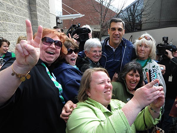 Jay Wright takes time to have a selfie taken with staff members. (Clem Murray/Staff Photographer)