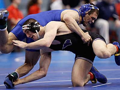 Iowa State´s Christopher Drouin, bottom, struggles against Air Force´s Cole VonOhlen during their 141-pound first round match. (AP Photo)