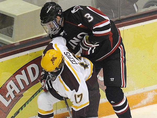 <br /><br />Nebraska Omaha&acute;s Andrej Sustr and Minnesota&acute;s Jacob Cepis battle for the puck in the first period of an NCAA college hockey game at Mariucci Arena in Minneapolis, Friday, Oct. 15, 2010. (AP Photo/Janet Hostetter)