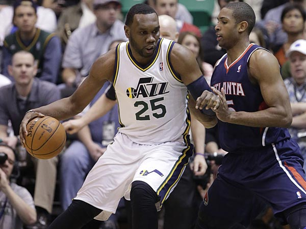 Atlanta Hawks´ Al Horford, right, guards Utah Jazz´s Al Jefferson (25) in the first quarter during an NBA basketball game Wednesday, Feb. 27, 2013, in Salt Lake City. (AP Photo/Rick Bowmer)