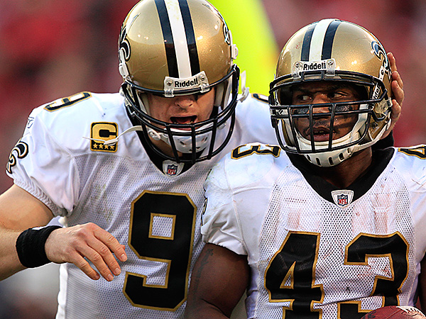 Former Saints running back Darren Sproles (43) celebrates with quarterback Drew Brees.  (AP Photo/Marcio Jose Sanchez)