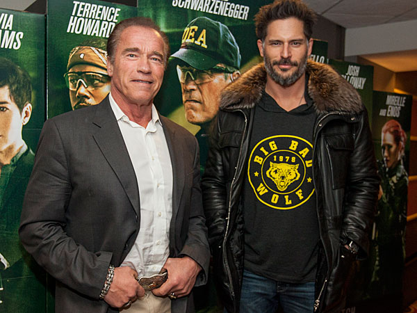 From left, actors Arnold Schwarzenegger and Joe Manganiello surprises audience members at a special advance screening of their new movie, Sabotage, at the AMC River East 21 theater on Sunday, March 2, 2014 in Chicago. (Photo by Barry Brecheisen/Invision/AP)