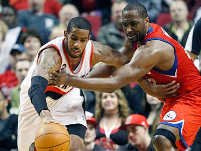 Sixers forward Elton Brand guards the Trail Blazers´ LaMarcus Aldridge on Saturday night. (Rick Bowmer/AP Photo)