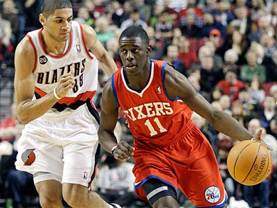 Jrue Holiday and the Sixers will take on the Blazers to start the season. (Rick Bowmer/AP Photo)