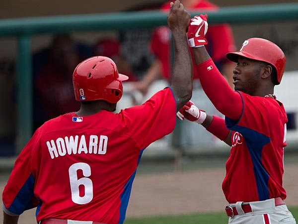 Philadelphia Phillies´ Ryan Howard, left, congratulates teammate Domonic Brown after he hit a two-run home run during the fifth inning of an exhibition spring training baseball game against the Atlanta Braves on Monday, March 18, 2013, in Kissimmee, Fla. (AP Photo/Evan Vucci)