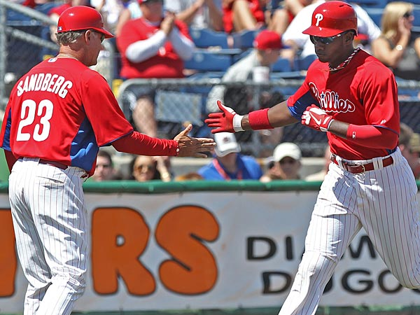 Phillies Dominic Brown gets a hand slap from third base coach Ryne<br />Sandberg as he rounds the bases for his two run home run. (Michael Bryant/Staff Photographer)