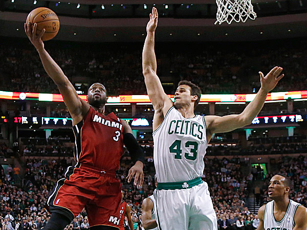 Dwyane Wade (left) averages 19.1 points and 4.7 assists per game for the Heat. (Elise Amendola/AP)