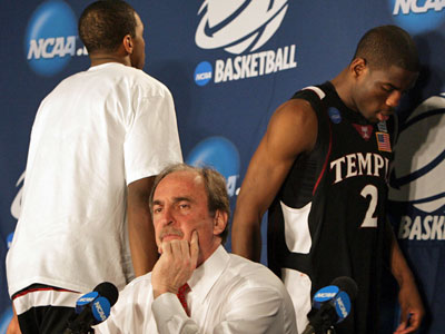 Temple´s Dionte Christmas (left) and Ryan Brooks leave the post-game press conference as head coach Fran Dunphy waits to answer questions after Temple lost to Arizona State in the first round of the NCAA men´s basketball tournament in Miami, Fla., on Friday. (Yong Kim / Staff Photographer)