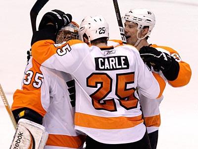 Philadelphia Flyers goalie Sergei Bobrovsky, Matt Carle and Darroll Powe celebrate after clinching a playoff bid. (AP Photo)