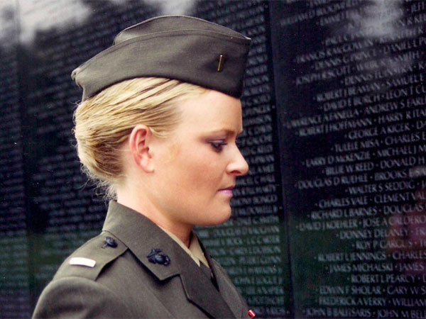 Lieutenant Elle Helmer at the Vietnam War Memorial, from THE INVISIBLE WAR.