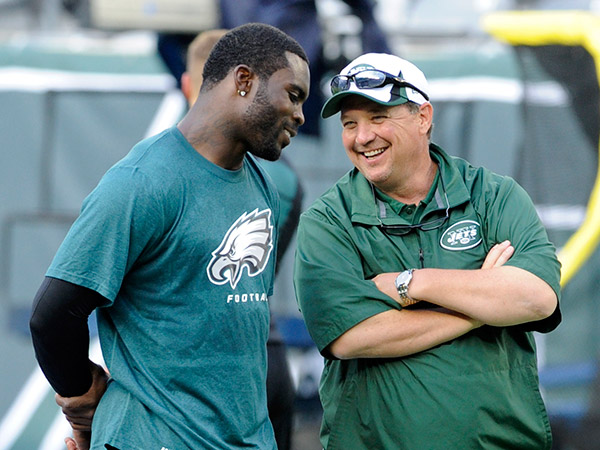Michael Vick (left) could be reunited with former Eagles offensive coordinator Marty Mornhinweg (right) if he joins the New York Jets.