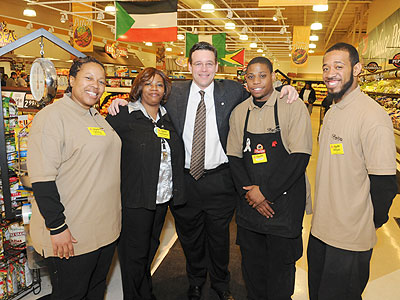 Jeff Brown (center), CEO of Brown's Super Stores Inc., with  (from left) Tammy Wilson, Lashawna Reddy, Tyrone Page and William Banks,  associates at his Parkside store on North 52d Street in Philadelphia.