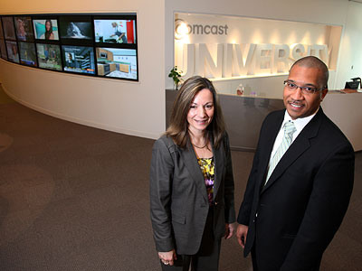 Kathy Avgiris, senior vice president and general manager of data services, and Ajamu Johnson, director of supplier diversity, at Comcast University in Philadelphia.