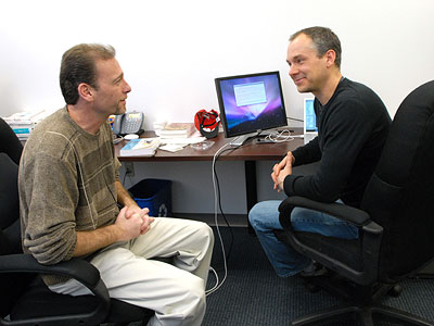 Chariot Solutions CEO Michael Rappaport (left) chats with software architect Matt Swartley in the company´s Fort Washington office.